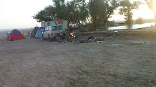 Some people were sleeping in the ground or in a tent near the caravanserai