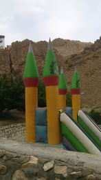Militarism is present in Iran: from the tank-shaped benches in Iran and rockets next to a mosqe, we found these missiles… in a playground…