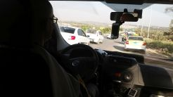 Adi took us to meet Sameh's father, Muhammed. We drove a bit and then separated: he had to go through an Israeli checkpoint for Arabs. We didn't. We drove by one designated for those cars which have Israeli number plates