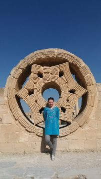 """Extremely disappointing visit to the Hisham's Palace. We didn't see the wonderful The """"Tree of Life"""" mosaic in the audience room of the bath house – it was being restored. Also, a wonderful, 7 million pieces mosaic…:( Bibi is pictured with an ornament from the former palace. Close to thos location we saw the Tell es-Sultan, a defensive or flood protection wall suggested to date to approximately 8000 before Christ. The Wall of Jericho is the oldest city wall discovered by archaeologists anywhere in the world"""