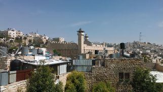 While searching the main entrance to the Jewish compound/settlement/neighborhood, we stumbled upon the Hebron Rehabilitation Committee. I entered and met Mr. Rafi. He let us up on the roof. We finally had a glance at the mosque. According to tradition that has been associated with the Holy Books Torah, Bible and Quran, the cave and adjoining field were purchased by Abraham as a burial plot. Dating back over 2,000 years, the monumental Herodian compound is believed to be the oldest continuously used intact prayer structure in the world, and is the oldest major building in the world that still fulfills its original function