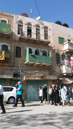 Arab residents of the buildings looking on with frustration
