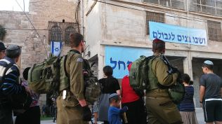 Israeli soldiers guarding a newly occupied house…